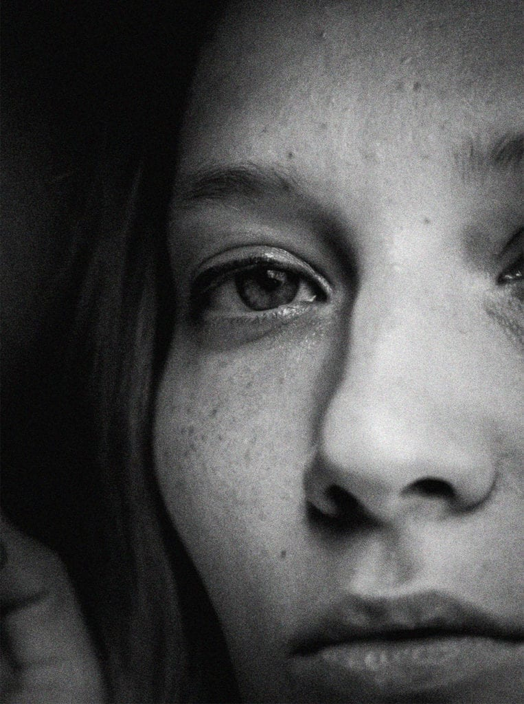 A black and white close up of a woman's eyes