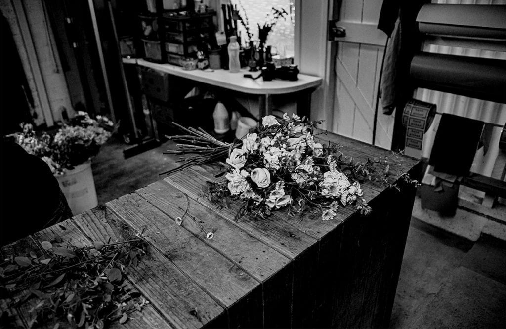 flowers resting on a table in a studio setting